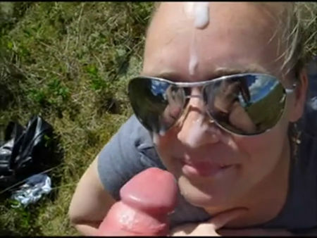 Beautiful girl in sun goggles makes an awesome blowjob by the road