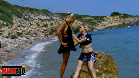 Guy fucks two sexy lesbians on the beach