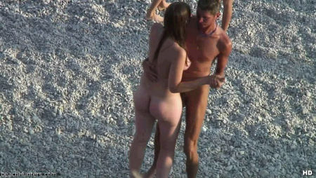 Naked teens on the beach dancing a slow dance
